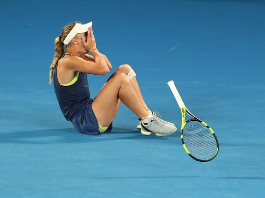 MELBOURNE, AUSTRALIA - JANUARY 27:  Caroline Wozniacki of Denmark reacts after winning championship point in her women's singles final against Simona Halep of Romania on day 13 of the 2018 Australian Open at Melbourne Park on January 27, 2018 in Melbourne, Australia.  (Photo by Chris Hyde/Getty Images) ORG XMIT: 775056579 ORIG FILE ID: 911261024