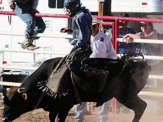 Isaac Devora rides a bull during a Sierra County 4-H Rodeo in Truth or Consequences.