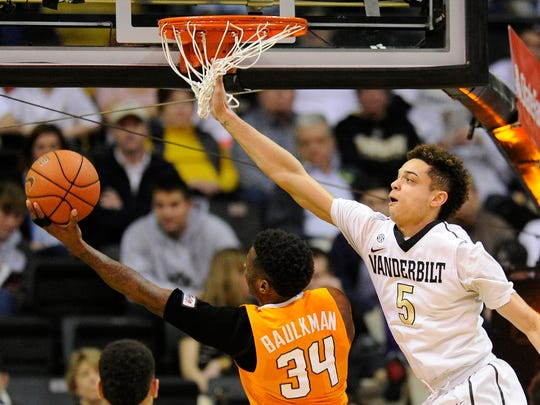 Tennessee guard Devon Baulkman (34) shoots past Vanderbilt