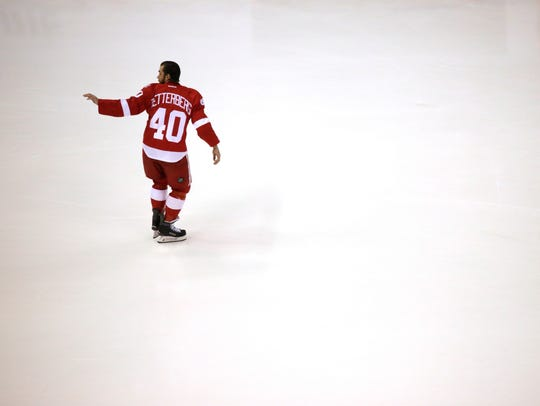 Red Wings captain Henrik Zetterberg waves to his family