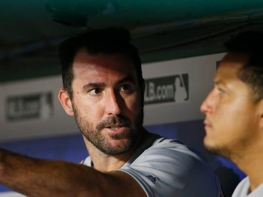 Pitcher Justin Verlander, then with the Tigers, talks to first baseman Miguel Cabrera in the dugout during a game on Aug. 15, 2017.  Verlander was traded to the Astros on Aug. 31.