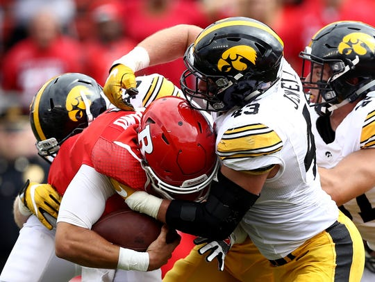 Rutgers quarterback Chris Laviano gets stuffed by Iowa