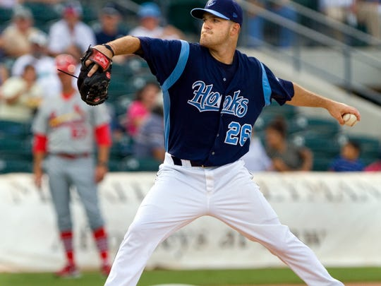 Hooks' starting pitcher Dallas Keuchel delivers to the first inning.