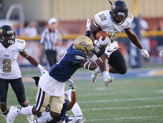 Northwest Rankin's Cameron Carroll (16) jumps high