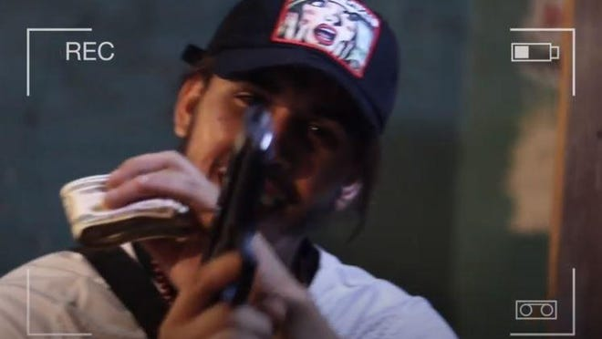 An image captured from the YouTube music video featuring murder suspect Felix Hernandez-Rosado.