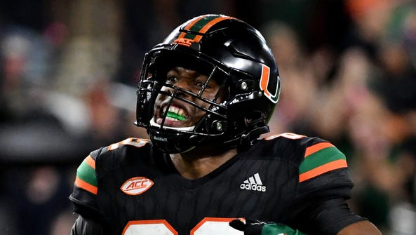 Ahmmon Richards (82) and the Miami Hurricanes have