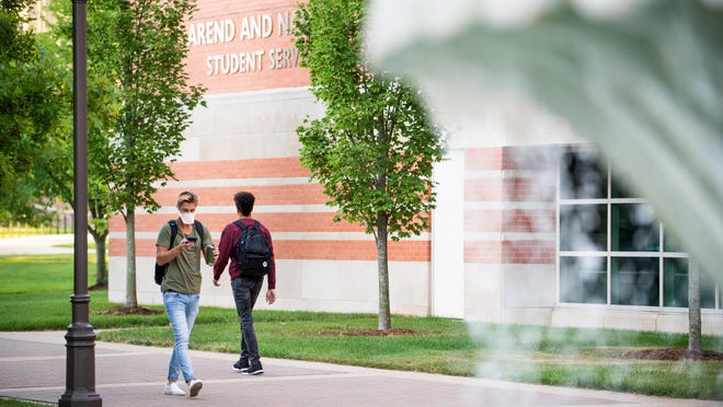 Students walk on campus during the first day of classes at Grand Valley State University on August 31, 2020. GVSU and Western Michigan University are offering students credits if they do leave campus early because of the pandemic.
