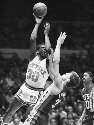 Knicks star Bernard King shoots over 76ers defender Jeff Turner in a 1984 game. King now will enter the Naismith Memorial Basketball Hall of Fame.