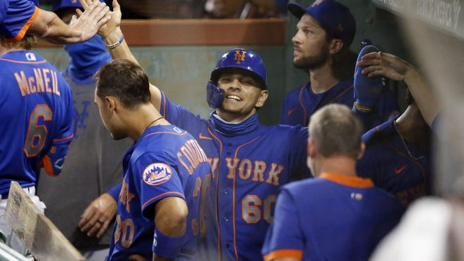 Andres Gimenez, center, plated a run in the eighth inning Tuesday night as the Mets polished off the Red Sox.