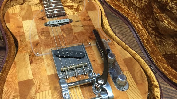 Sound investment: CEO turns reclaimed wood into guitars