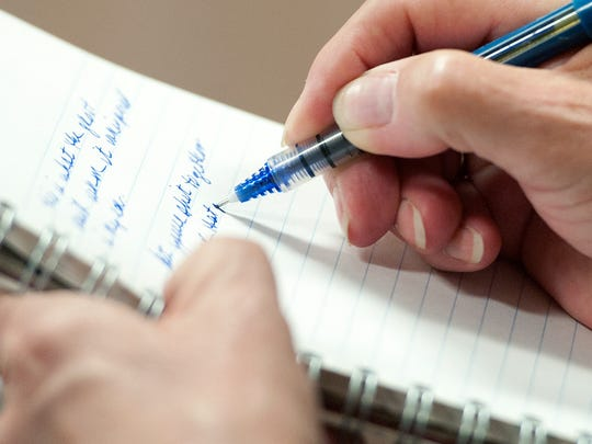 Leslie Bonnette of Shelburne writes in response to a prompt during a Writers for Recovery session at the Turning Point Center in Burlington on July 16.