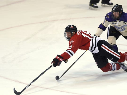 St. Cloud State center Judd Peterson reaches toward