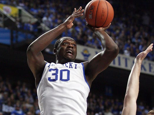 Kentucky Wildcats forward Julius Randle shoots the ball against Northern Kentucky Norse forward Jack Flournoy at Rupp Arena.