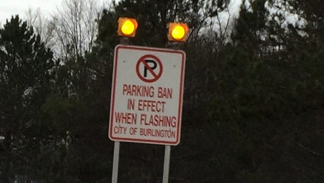 A sign alerts motorists that Burlington's parking ban is in effect