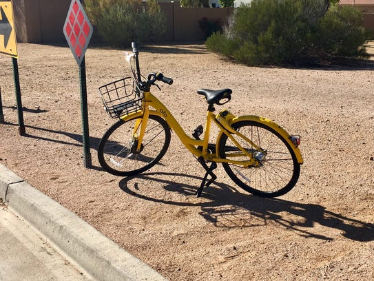 This ofo bike was left parked at 84th Street just north