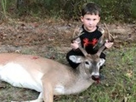 JMac Hill, 5, had to back off shooting a doe when his