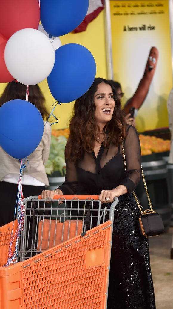 Movie premiere+ grocery store = multitasking for celebrities.