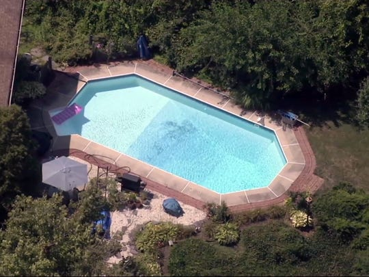 The pool where a 2-year-old girl was found floating lifeless Monday evening at 2 Teal Place in Berkeley Township is shown in this aerial image provided by NBC10 News.
