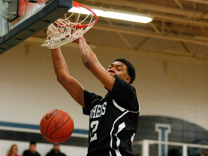 PRP's Lamontray Harris , #32, dunks over Iroquois during their game at the Iroquois High School.     Feb. 11, 2014