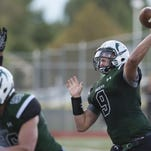 Fossil Ridge quarterback Griffin Roberts, shown earlier this season, threw for 290 yards and two touchdowns in the SaberCats' 41-16 win at Monarch Thursday night.