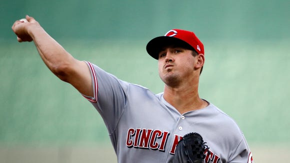 Cincinnati Reds starting pitcher Tyler Mahle throws