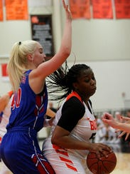Burkburnett's Kyndall Hightower protects the ball from