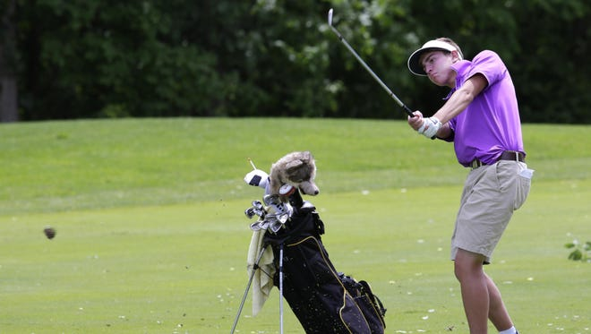 Sheboygan Falls' Austin Madden hits an approach shot during the first round of the WIAA State Tournament at University Ridge on Monday.
