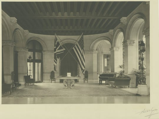 The Union Jack and the Stars and Stripes hang in Biltmore's Entrance Hall at the time of Cornelia Vanderbilt's wedding to the Hon. John Cecil, a British aristocrat.