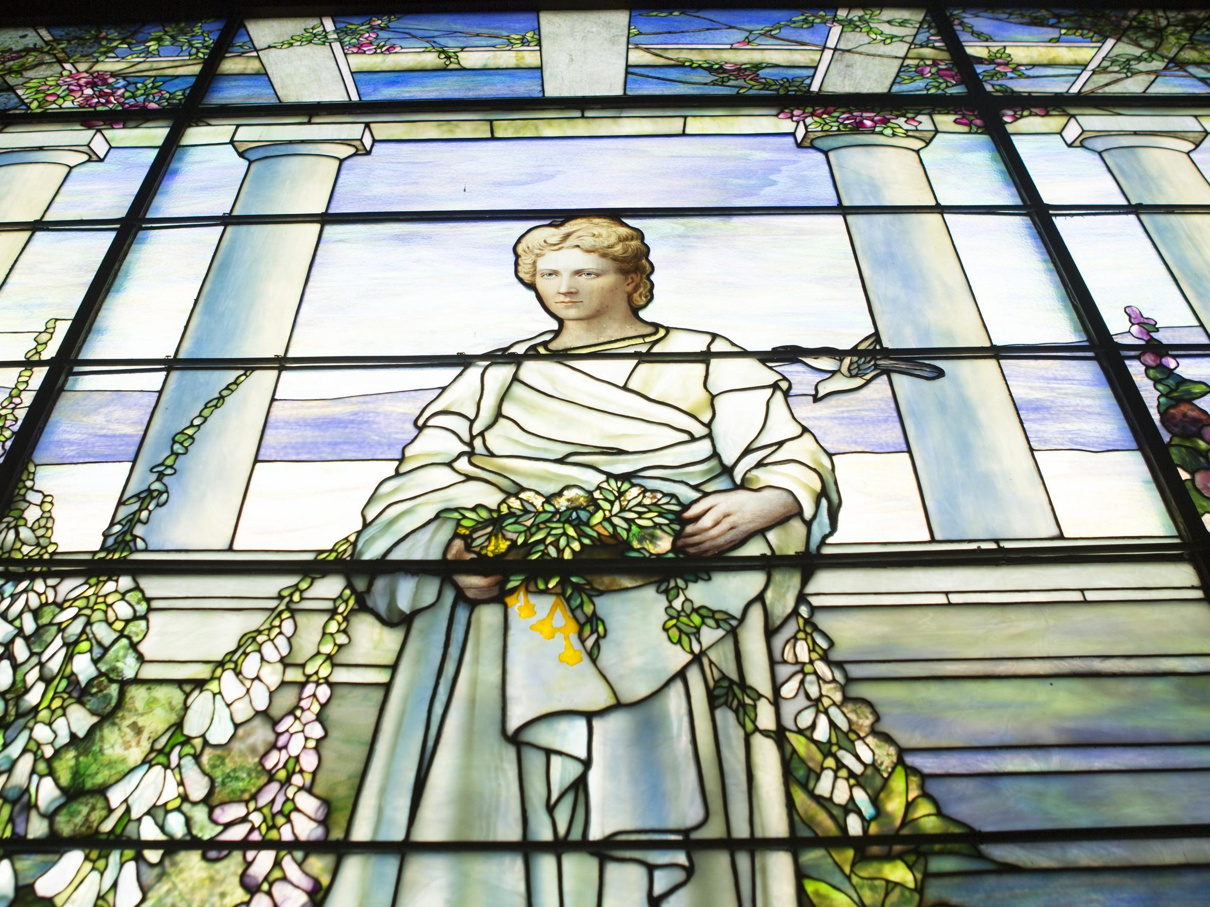 A massive Tiffany stained glass window depicting Sallie