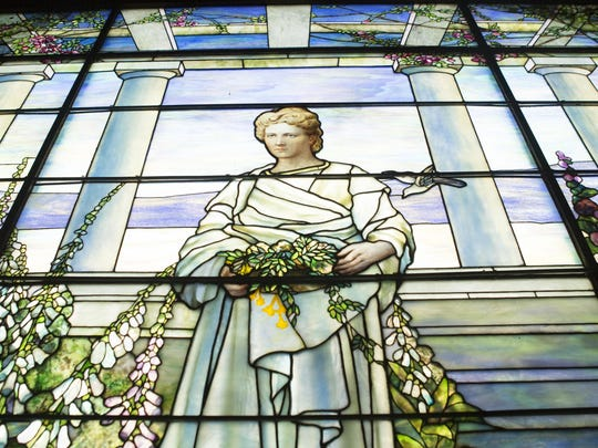 A massive Tiffany stained glass window depicting Sallie Mae Dooley, protected by bulletproof glass, is on display inside Swannanoa on Sept. 10, 2015.