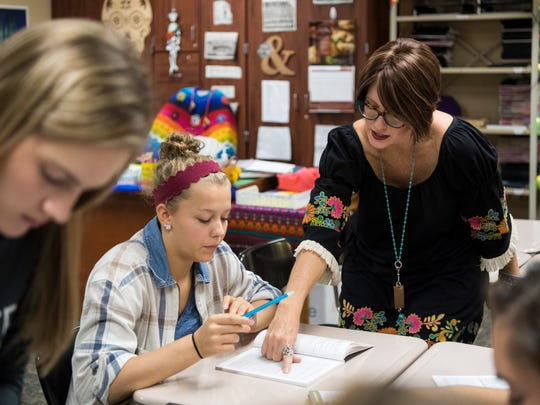 Spanish teacher J.J. Epperson (right) talks through a Spanish phrase with senior student Regan Happe (left) during the third period Level Four Spanish class at Gibson Southern High School in Fort Branch, Ind., Tuesday, Oct. 10, 2017.