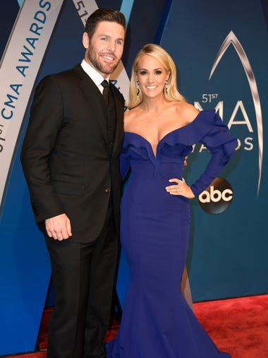 Carrie Underwood and husband Mike Fisher on the red
