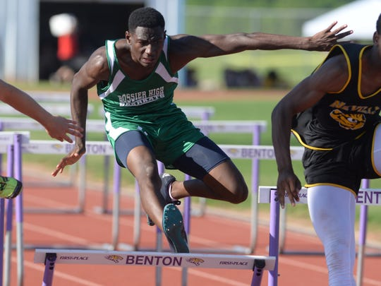 Bossier's Xavier Venious hits a hurdle in the boy's 100m hurdles at the Region I- Class 4A track meet at Benton High School.