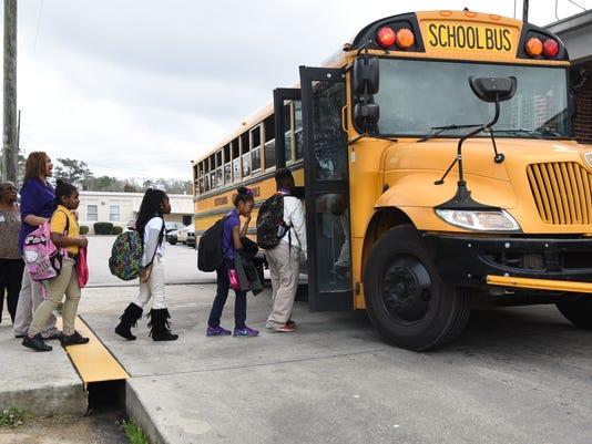 Students boarding school bus