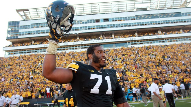 Iowa's Carl Davis celebrates the Hawkeyes' win over Ball State after recovering a fumble in the final moments at Kinnick Stadium on Saturday, Sept. 6, 2014. David Scrivner / Iowa City Press-Citizen