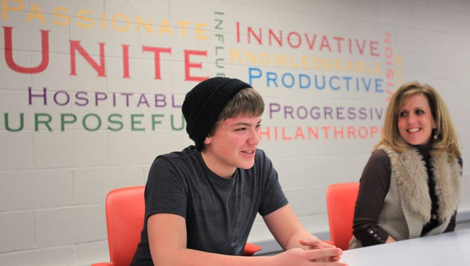 Danny Murray, 18, left, talks about his experiences at Center Grove Alternative Academy, Tuesday, January 14, 2014, as Director of Center Grove Alternative Academy Beth Bryant listens.  Murray is a homeless student and is set to graduate this year.