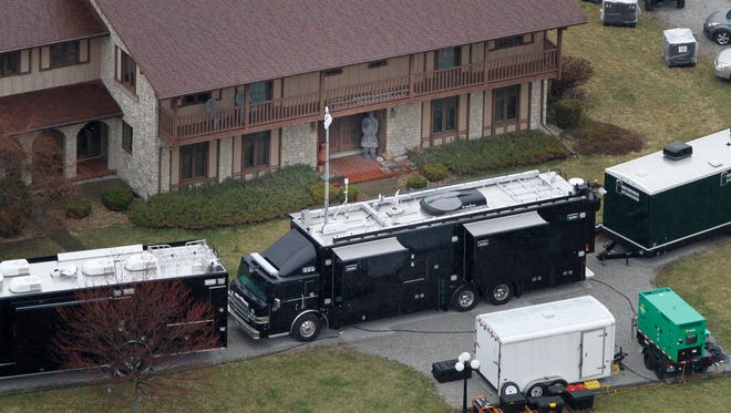 FBI agents work around a home in Rush County to confiscate what the agency is calling artifacts, Wednesday, April 2, 2014.  From WTHR Chopper 13.