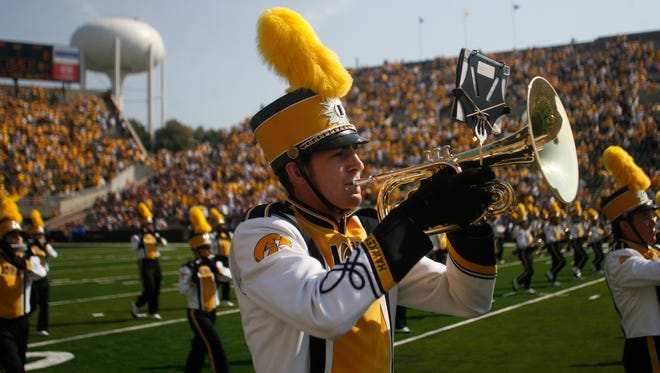 The Iowa marching band takes the field before the start of the home opener against UNI,  Saturday, September 5, 2009, at Kinnick Stadium, in Iowa City, Iowa.