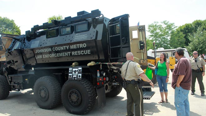 People check out the interior of Johnson County's Mine Resistant Ambush Protected vehicle at the Johnson County Fair on Tuesday, July 22, 2014. David Scrivner / Iowa City Press-Citizen