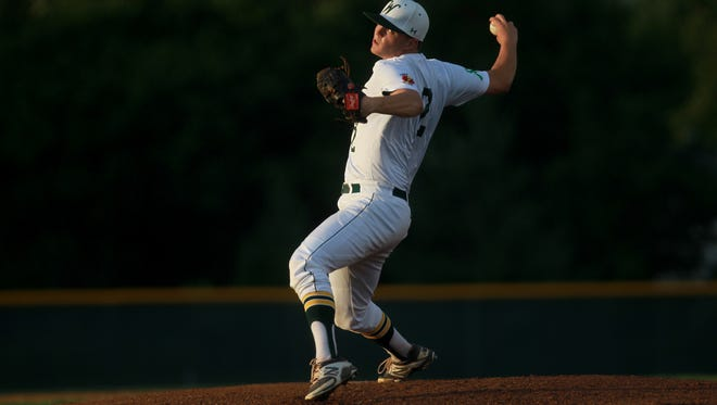 West High's Tyus Adkins delivers a pitch during the Trojans' game against City High at West High on Monday, July 7, 2014.