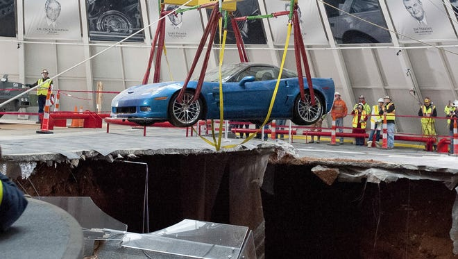 Alex Slitz, AP A Chevrolet Corvette is hoisted from a sinkhole inside the National Corvette Museum Monday in Bowling Green, Ky. Eight of the museum?s cars plunged into the hole last month and will be restored. One of eight Chevrolet Corvettes is removed from a sinkhole in the Skydome at the National Corvette Museum, Monday, March. 3, 2014, in Bowling Green, Ky.  On Feb. 12, a large sinkhole swallowed eight prized cars like they were toys, piling them in a heap amid loose dirt and concrete fragments. (AP Photo/Daily News, Alex Slitz)  ORG XMIT: KYBOW104