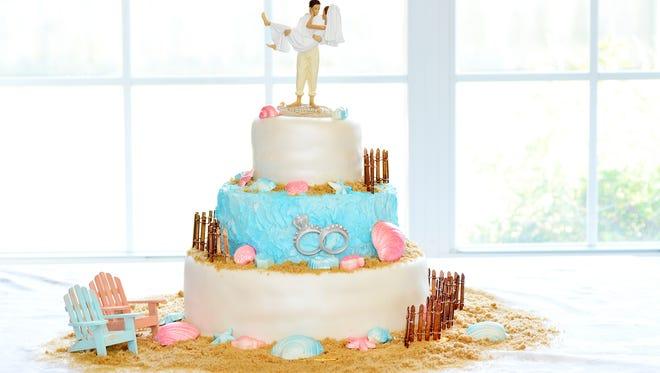 A beach themed wedding cake by Julonda Carter at JC Creations.