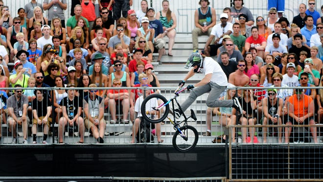 Scotty Cranmer flies through the air in front of a large crowd during Friday's semifinals at the BMX Bowl.