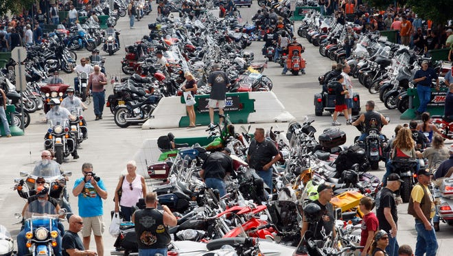 FILE - In this Aug. 6, 2013 file photo, thousands of bikers flock to Main Street in Sturgis, S.D., for the annual Sturgis motorcycle rally. Sturgis Motorcycle Rally organizers will welcome traditional bikers when the 74th annual rally begins Monday, Aug. 4 and also try to draw younger riders in hopes they make it a habit as it has been for baby boomers. The rally runs Aug. 4-10. Attendance is expected to top last year's 466,000, based on reservations and inquiries. (AP Photo/Rapid City Journal, Chris Huber, File)