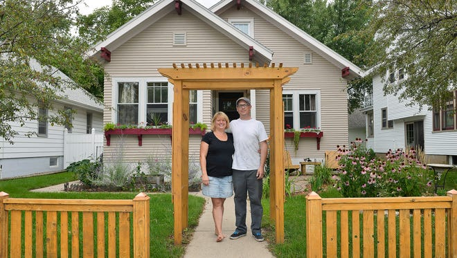John and Astra Seitz pose outside the home they've continuously updated since they bought the property at 703 McKinley Place 11 years ago. The home will be on The Lake George Hidden Treasures Historic Home Tour.