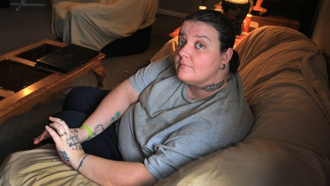 Betina Pierson sits in her home in Thorntown, Ind., Wednesday, Dec. 4, 2013.  Her daughter, Tierra Pierson and Tierra's cousin, January Canada, were hit by a drunken driver after an Indianapolis Colts game in December 2010.