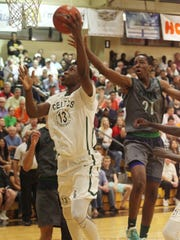 Chino Hills' Onyeka Okongwe attempts to block the shot of  The Patrick School's Cyril Langevine  during the Championship game of the City of Palms Classic on Wednesday night.