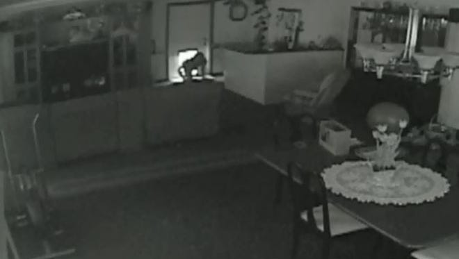 A suspect can be seen entering a home in the 200 block of Northwest Bayshore Boulevard in Port St. Lucie on April 19, 2017, in a still from the homeowner's surveillance video.