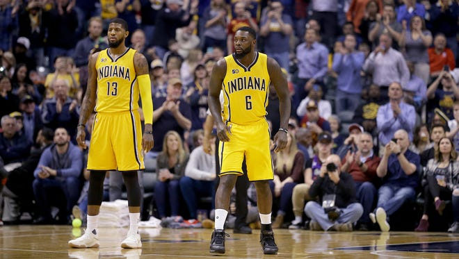 Indiana Pacers guard Lance Stephenson (6) checks into the game next to Paul George,left, in the first half of their game against the Toronto Raptors Tuesday, April 4, 2016, evening at Bankers Life Fieldhouse.