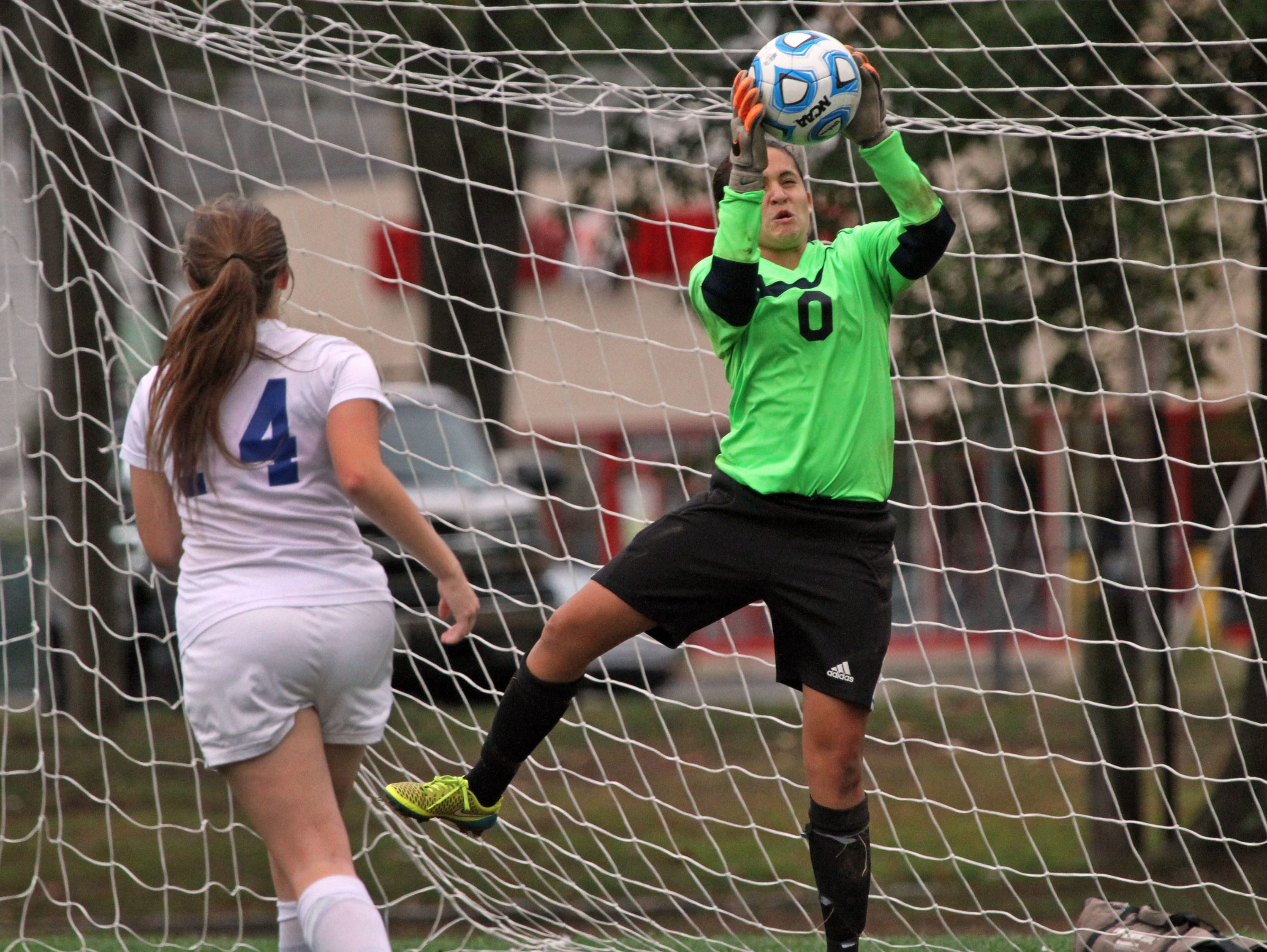 Middlesex goalie Nicole Fallon makes a save in girls soccer game versus Metuchen at home.